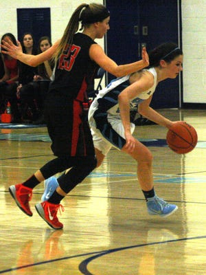 Stevenson's Diane Senkowski drives to the basket against Churchill's Natalie Spala.