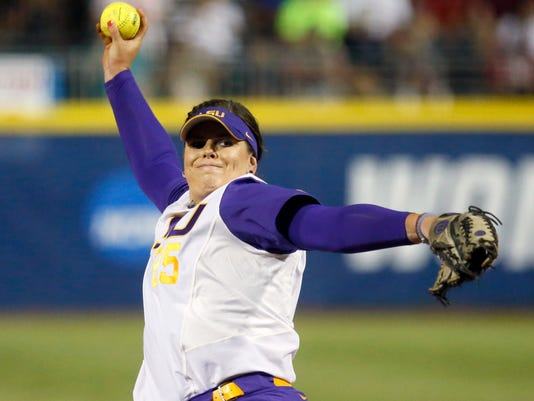 LSU's Allie Walljasper pitches against Oklahoma in the first inning of an NCAA Women's College World Series softball game in Oklahoma City, Sunday, June 5, 2016. (AP Photo/Sue Ogrocki)
