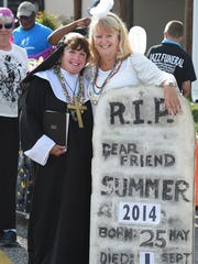 """""""Angel"""" Carolyn Bacon from Fenwick Island & """"Sister"""" Marie Wright from Bethany come every year to participate as at the Bethany Beach Jazz Funeral."""