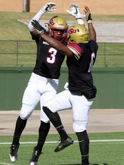 Midwestern State's Tyrique Edwards (3) and Brandon Sampson (6) celebrates Edwards touchdown against Sioux Falls Saturday, Nov. 18, 2017, at Memorial Stadium. The Mustangs defeated the Cougars 24-20 in the first round of the NCAA DII Playoffs.