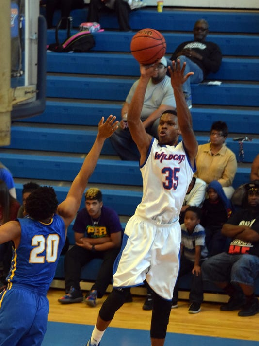 Louisiana College's Anthony Gaines Jr., (35, right) shoots against LeTourneau's C.J. Bird (20, left) Saturday.
