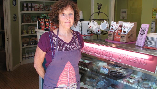 Kathleen McGlone, owner of Slow Pokes Local Foods in Grafton, is challenging the constitutionality of a Wisconsin law that bans the sale of butter that hasn't been graded by the state or federal government.