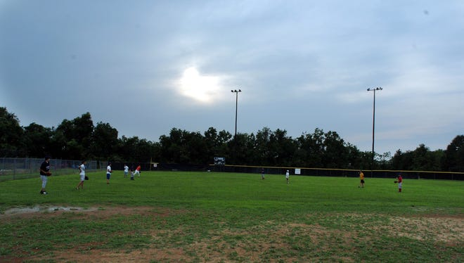 A Pony League baseball game takes place at Arceneaux Park in Broussard.