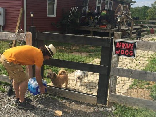 Erin Mayor Paul Bailey leaves a case of bottled water