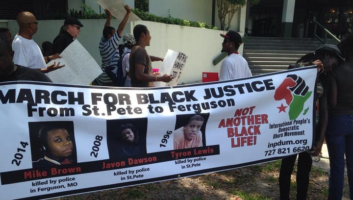 Protesters march from Uhuru House to the St. Pete Police Department headquarters for Mike Brown and others killed by police.