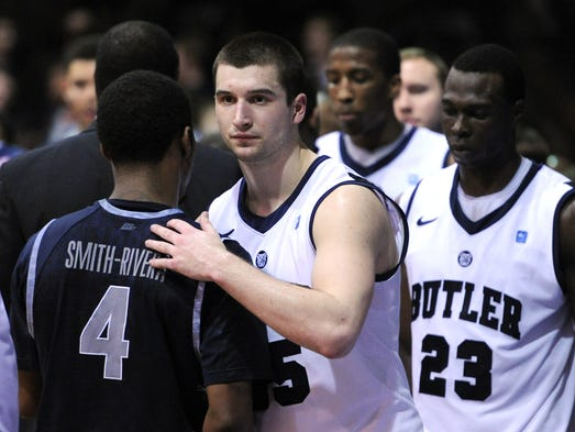 Butler forward Andrew Chrabascz walks off the court after losing 70-67 in overtime to Georgetown inside Hinkle Fieldhouse, Saturday, January 11, 2014, in Indianapolis.