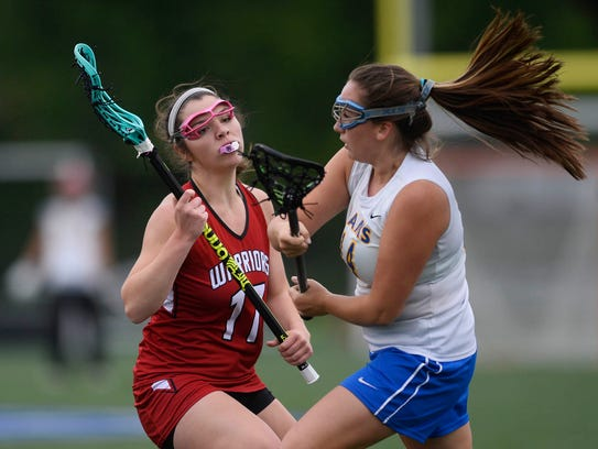 Kennard-Dale's Maddie Day passes under pressure from