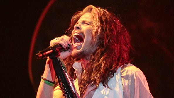 Steven Tyler performs for fans at the Comerica Theatre