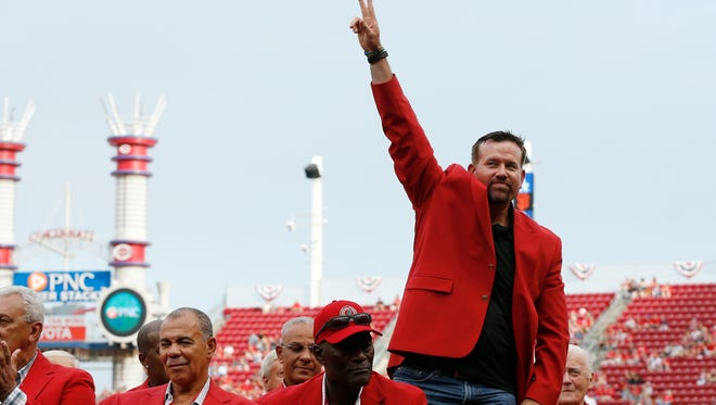 Former Reds player and Reds Hall of Famer Sean Casey waves to fans as he participates in the Reds Hall of Fame induction ceremony prior to a game in August of 2014.
