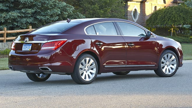 The 2014 Buick LaCrosse is available with eAssist, a mild hybrid system that boosts mpg.