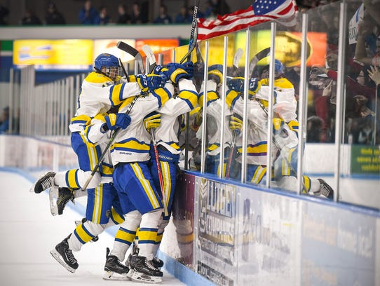 Cathedral players celebrate a goal with the student