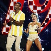"""Former Lions wide receiver Calvin Johnson Jr. and partner Lindsay Arnold earned high scores for footwork on Monday's """"Dancing with the Stars."""""""