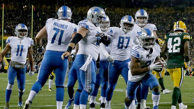 Ameer Abdullah (21) celebrates with teammates after scoring a touchdown in the second quarter against the Packers at Lambeau Field on Monday, Nov. 6, 2017 in Green Bay.