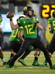 Oregon quarterback Taylor Alie (12) throws a pass against California. The Ducks won 45-24.