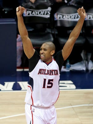 Al Horford celebrates after his game-winning bucket gave the Hawks a 3-2 series lead.