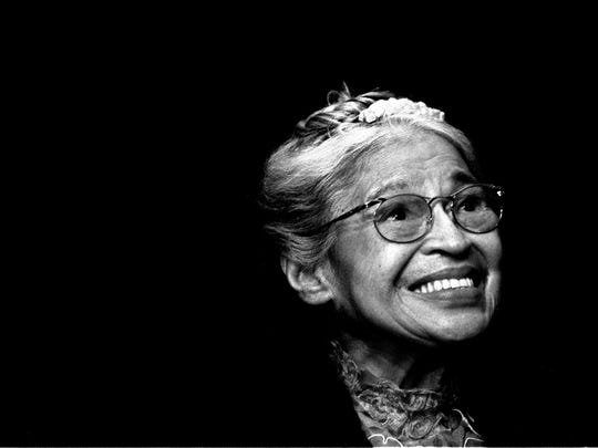 In this Nov. 28, 1999, file photo, Rosa Parks smiles