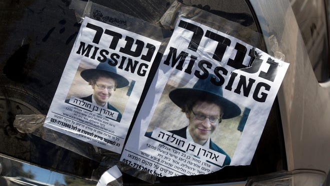 Posters showing a picture of Aharon Sofer, 23, a missing ultra-Orthodox Jewish student, were on display as volunteers searched for him in  Jerusalem Forest on Thursday.