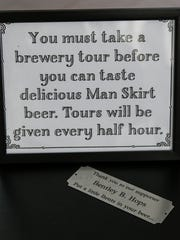 A sign in Man Skirt Brewing.