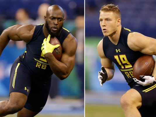 FILE - At left, in a March 3, 2017, file photo, LSU running back Leonard Fournette runs a drill at the NFL football scouting combine in Indianapolis. At right, also in a March 3, 2017, file photo, Stanford running back Christian McCaffrey runs a drill at the NFL football scouting combine in Indianapolis. The Panthers hold the eighth pick in the NFL draft and running backs McCaffrey and Fournette are among the possibilities.  (AP Photo/Michael Conroy, File)