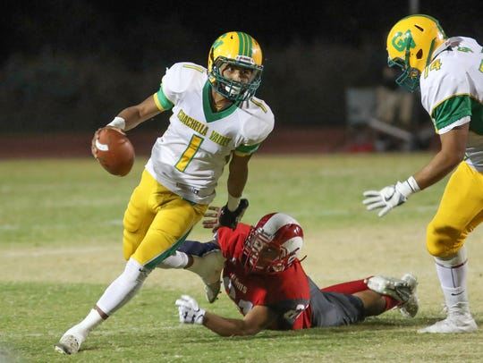 Coachella Valley quarterback Armando Deniz avoids a