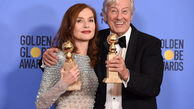 "Actress Isabelle Huppert, winner of Best Actress In A Motion Picture for ""Elle,"" and director Paul Verhoeven, winner of Best Foreign Language Film for ""Elle,"" pose at the Golden Globe Awards."
