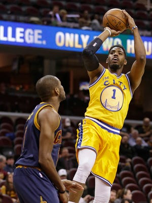 The Warriors'' Jason Thompson shoots over the Cavaliers' James Jones in the second half. The Warriors won 132-98.