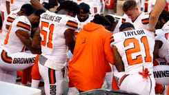 Members of the Cleveland Browns kneel during the national anthem before an NFL preseason football game between the New York Giants and the Cleveland Browns, Monday, Aug. 21, 2017, in Cleveland. (AP Photo/Ron Schwane) ORG XMIT: CDS10