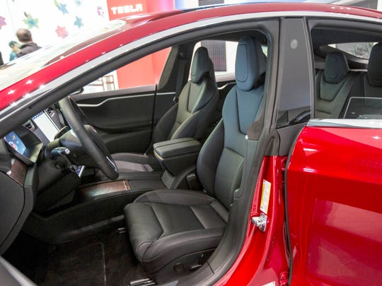 The interior of the Tesla Model S is seen in the showroom