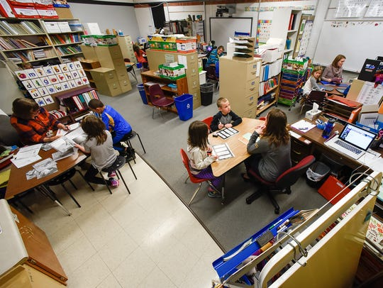 Teachers try to create makeshift boundaries and divide