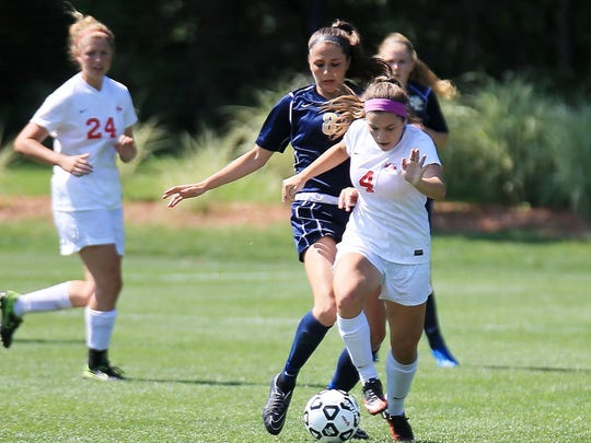 Trying to stay a step ahead of Stoney Creek's Emily Solek is Canton's Kaleigh Mahaz (right). At left for the Chiefs is Baylee Kramer.