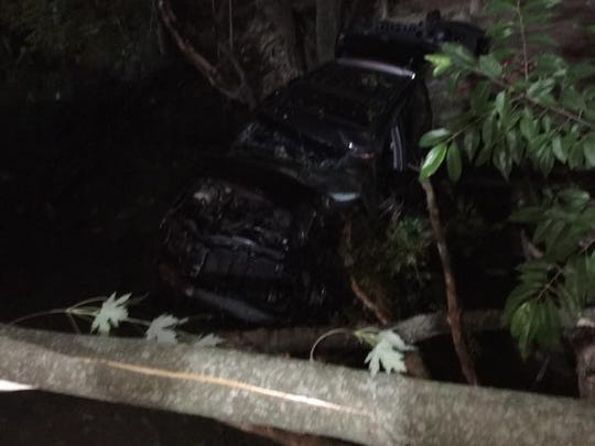 A driver was trapped inside this Jeep, and a cow was