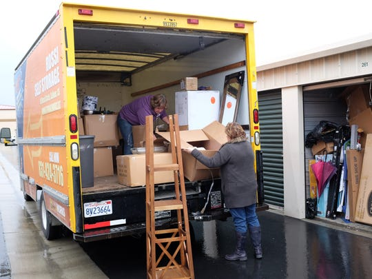 Susan Derichsweiler, left and Margie Weibusch go through a load of donations made to the Monterey County Foster Parent Association.