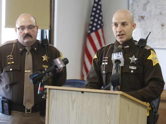 Caroll County Sheriff's Deputy Drew Yoder (right) speaks publicly Friday, Jan. 6., 2017, for the first time since a Nov. 21 fire in Flora that killed four children.