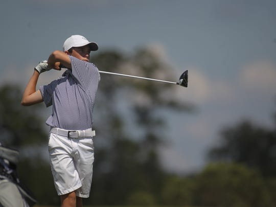 Maclay freshman Patrick McCann hits his tee shot on