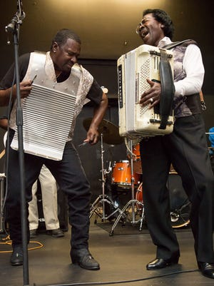 Sir Reginald Dural, left, jams with his father, Stanley Dural, leader of the band Buckwheat Zydeco. Reginald leads a Tribute to Buckwheat Zydeco March 18 at the SXSW Conference in Austin.