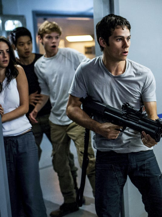 """From left, Kaya Scodelario, Ki Hong Lee, Thomas Brodie-Sangster, and Dylan O'Brien appear in """"Maze Runner: The Scorch Trials."""""""