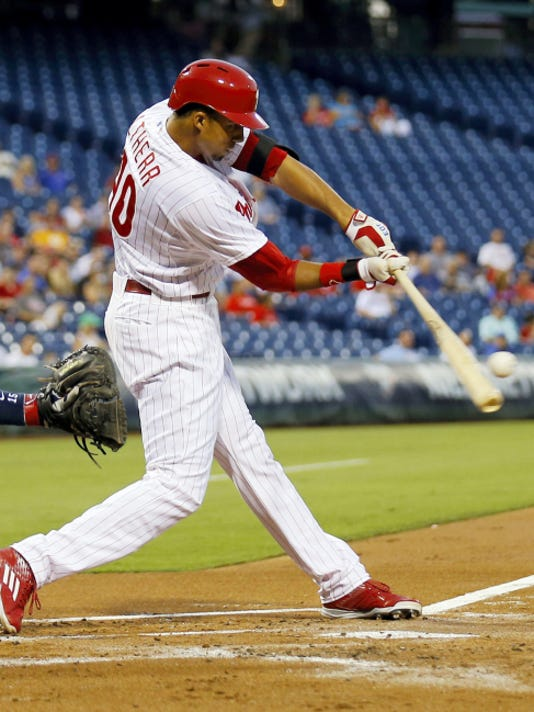 Phillies' Aaron Altherr hits a first inning triple against the Atlanta Braves on Monday in Philadelphia. The Braves ended a 12-game losing skid with a 7-2 victory in front of the smallest crowd at Citizens Bank Park history.