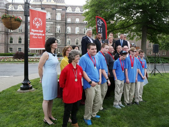 Special Olympics New York athletes, staff and local