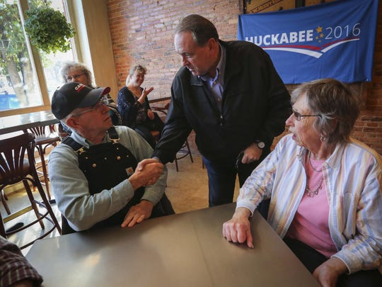 SOUTHERN HANDSHAKES: Republican presidential hopeful former Arkansas governor Mike Huckabee shakes hands with Tom Kaldenberg, right, of Albia, at the Albia Brewing Co., Thursday Nov. 19, 2015.