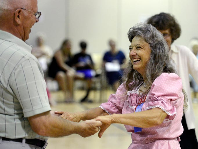 Bob Percy dances with Sandy Abney Saturday night at the Shirts and Skirts Square Dance Club dance at Active Generations, Aug 2, 2014.