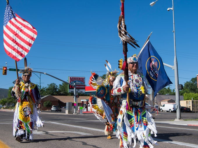 Members of the Paiute tribe march down Main Street