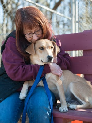 Voorhees Animal Orphanage Marketing Director Jennifer Bailey hugs a female retriever mix named Sunny at the Voorhees Animal Orphanage. Spending time with animals, as a volunteer, pet sitter or pet owner, is a great way to get a healthy dose of touch in your life.
