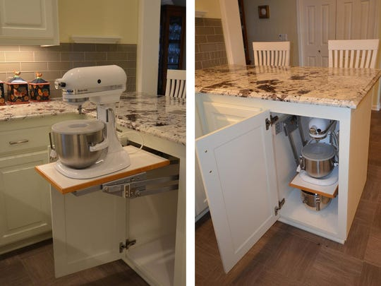 Install sliding shelf organizers in lower cabinets such as this hidden lift for kitchen mixer.