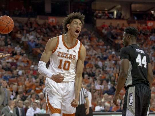 Texas forward Jaxson Hayes (10) shouts after scoring a basket while being fouled during an NCAA college basketball game against Providence on Friday, Dec. 21, 2018, in Austin, Texas. (Nick Wagner/Austin American-Statesman via AP)