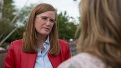 Christine Jones speaks to a supporter at a meet-and-greet