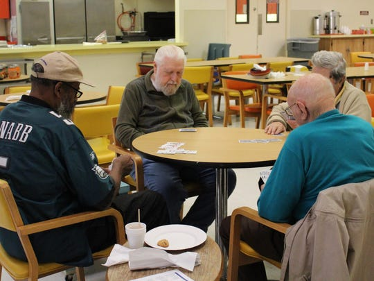 Seniors play cards at the Senior Nutrition Center.