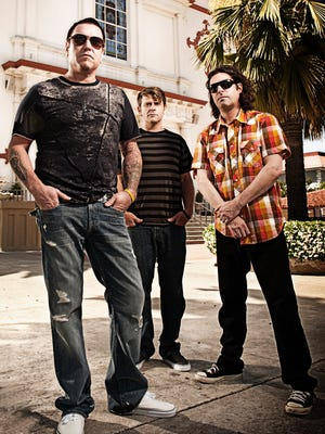 Steve Harwell, Michael Klooster and Paul De Lisle of the band Smash Mouth will perform Friday at the Midland Theatre.