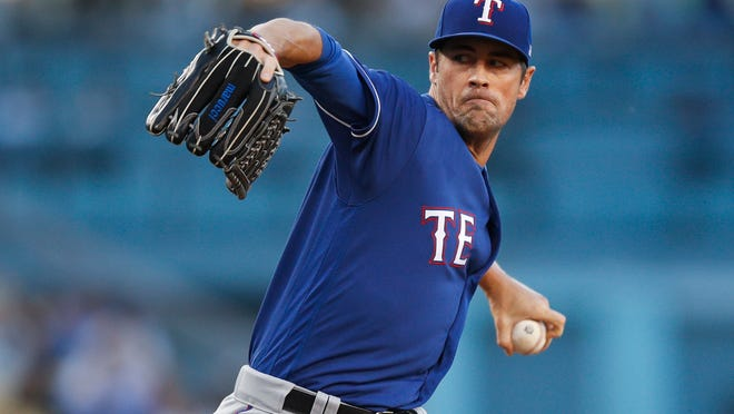 FILE - In this June 13, 2018, file photo, Texas Rangers starting pitcher Cole Hamels throws to a Los Angeles Dodgers batter during the first inning of a baseball game in Los Angeles. Teams trying to make a push for the postseason are always looking to add new arms. There's some big names available on the trade market who can make a difference in the starting rotation or bullpen. Hamels has a career-worst 4.36 ERA and he's already allowed 21 homers but he's a proven lefty who could benefit from pitching away from a hitter-friendly ballpark. (AP Photo/Jae C. Hong, File)