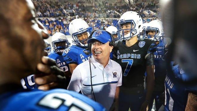 Sports radio host Gary Parrish fills in as a guest coach during the University of Memphis Tiger's annual spring scrimmage at the Liberty Bowl Friday Night.