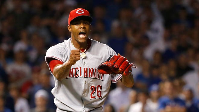 Cincinnati Reds relief pitcher Raisel Iglesias reacts after getting the last out of the Reds' 2-1 win over the Chicago Cubs in a baseball game Tuesday, Aug. 15, 2017, in Chicago. (AP Photo/Charles Rex Arbogast)